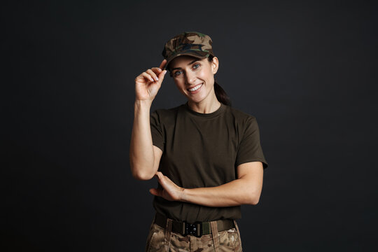 Happy beautiful soldier woman standing isolated