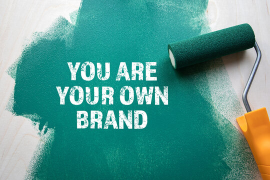 You Are Your Own Brand. Green painted wooden background