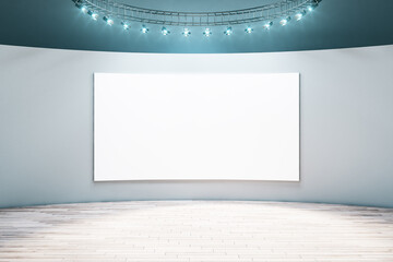 Spacious empty hall room with blank white poster on light wall, parquet floor and led light on top....