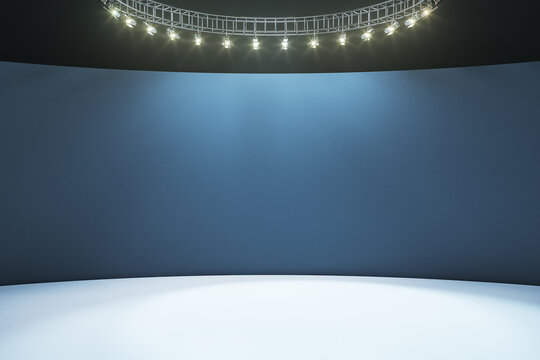 Empty hall room with dark blank wall, white floor and led light on top. Mockup
