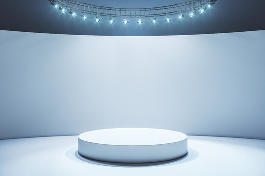 White round podium in empty stylish hall with light wall and floor and led lights on top
