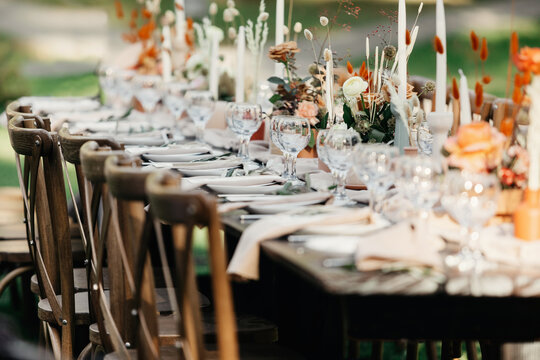 Boho wedding table for guests at bouquet after wedding ceremony and photo for marriage blog about interior