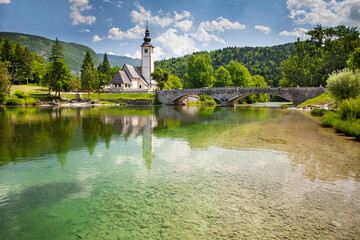 Wall Mural - View of the Church of St. John the Baptist on the banks of the Sava river near Lake Bohinj in Slovenia
