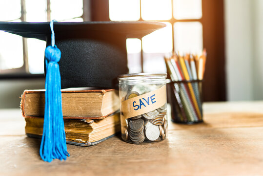 hat graduation and money coins saving for concept investment education and scholarship