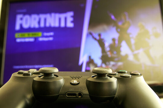 Video game on PlayStation 4 console. Point of view shot. Video games addiction. Fortnite gameplay