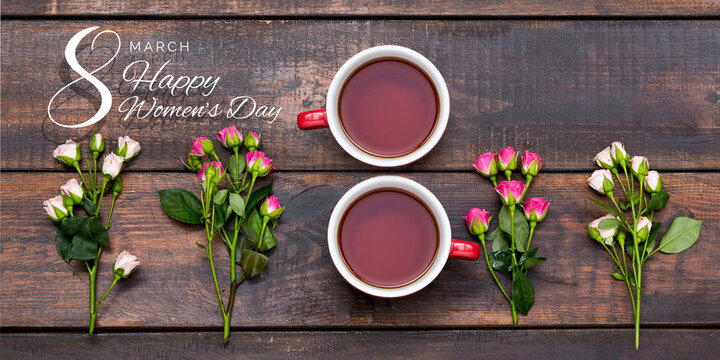 Composition of two cups of tea in shape of number eight 8 with beautiful flowers roses isolated on wooden table. Postcard for Women's Day March 8th. Concept of holidays, greetings. Copy space for ad