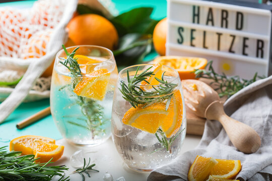 Hard seltzer cocktail with orange and zero waste bartenders accessories