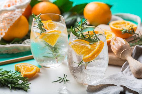 Hard seltzer cocktail with orange and zero waste bartenders accessories