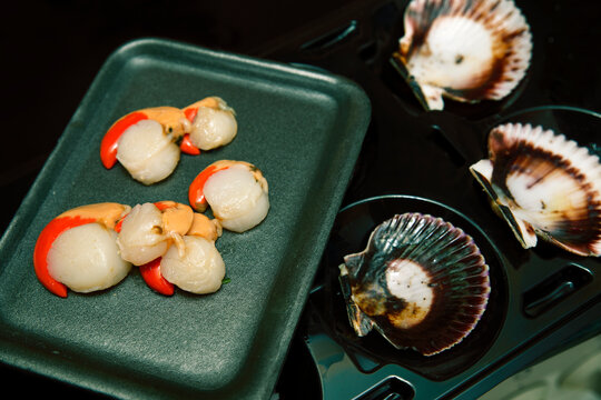 scallops separated from their shells. fresh seafood. ready to cook