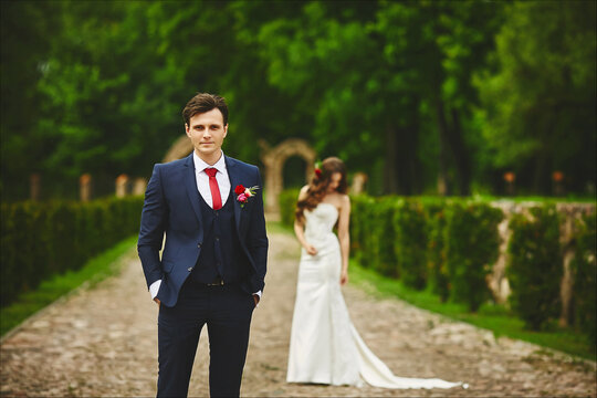 Handsome man in a bridal suit is waiting for the meeting with her bride. Couple before the wedding ceremony