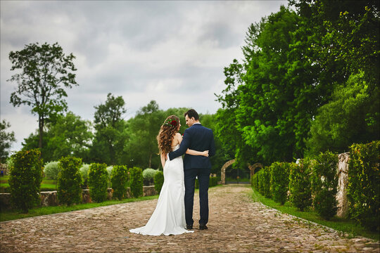 Stylish couple of newlyweds walking together after the wedding ceremony