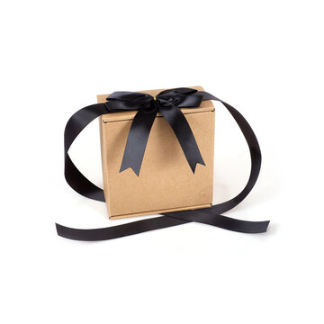 One craft box with black bow isolated on white background