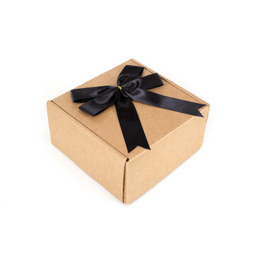 One craft boxes with black bow and ribbon isolated on white background