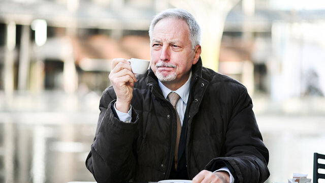 Senior manager having a coffee outdoor