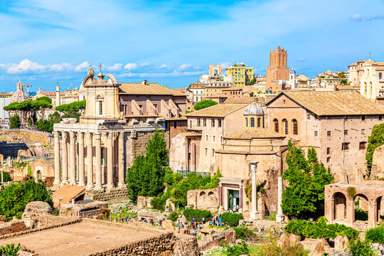 Panoramic cityscape view of the Roman Forum and Roman Altar of the Fatherland in Rome, Italy. World famous landmarks in Italy during summer sunny day