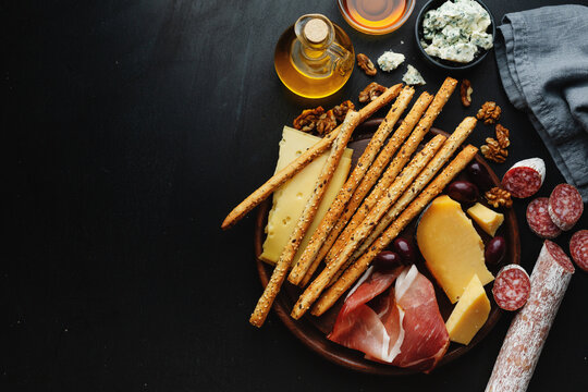Italian appetizers on dark background