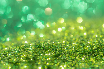 Spring sparkle background. Green colorful sparkles. Abstract advertising.