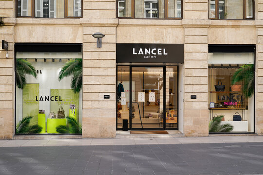 Lancel logo store text and brand sign on facade shop entrance in street