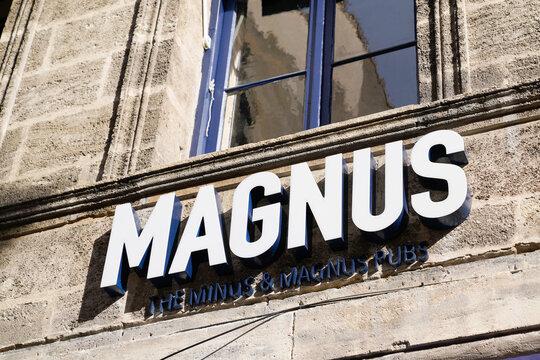 magnus sign text logo of French pub bar coffee
