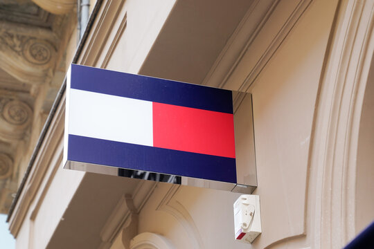 Tommy Hilfiger logo flag colors store front of brand premium American clothing company sign shop