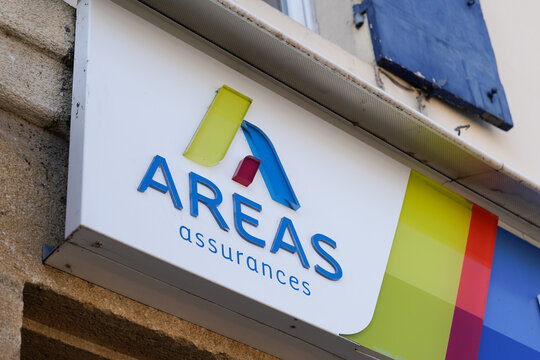 areas assurances insurance brand sign and text logo front of wall store office shop building