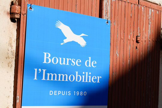 Bourse de l'immobilier sign blue bird logo brand and text front of real estate agency broker office company