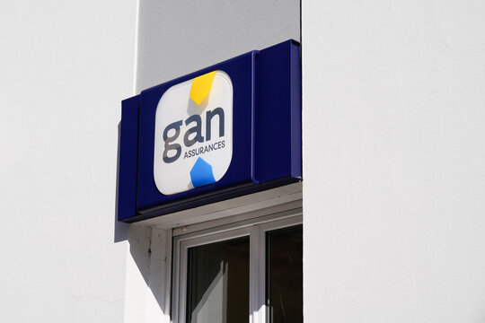 Gan insurance sign logo and brand text on agency wall building office store