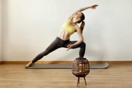 Young attractive woman practicing yoga on a gym mat. Yoga, fitness, lifestyle