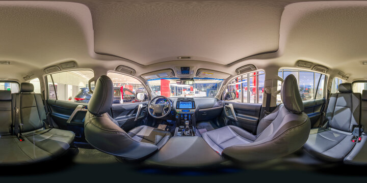 Batumi, Georgia - December 6, 2020: Full 360 by 180 degree angle equirectangular equidistant spherical panorama in the interior of prestige modern car Toyota Prado. 360 panorama as VR content