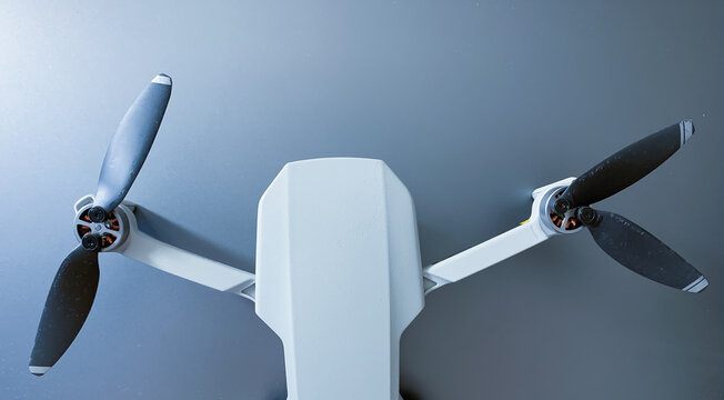 Small drone with propellers, metallic background