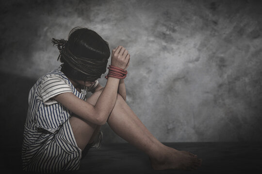 A victim tied up with rope. Stop human trafficking. Children abuse concept.