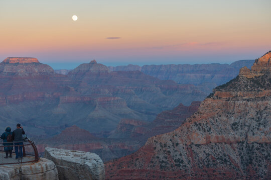 Moon in the grand canyon at sunset.