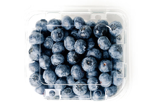 transparent blueberry jar, on white background, with closed lid, viewed from above, horizontal format