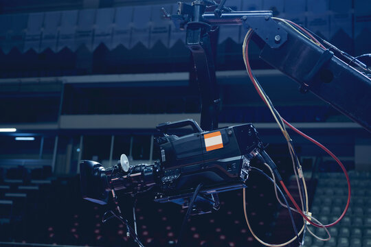 TV camera of a crane on a football mach or concert