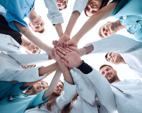 bottom view. a group of medical colleagues putting their hands together.