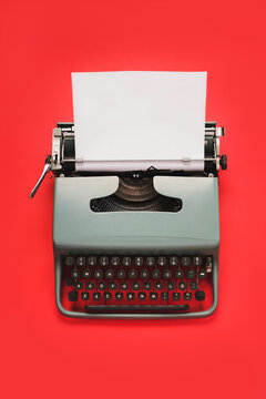 Vintage typewriter with white paper isolated