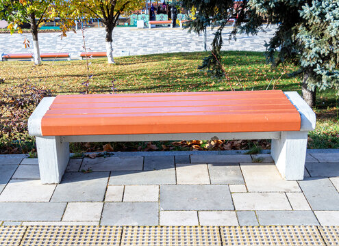 Wooden bench at the city street in summer