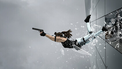 Woman playing on the simulator, holding gun.   Blockbuster, action movie