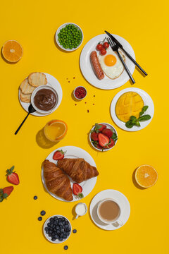 Sunny tasty continental breakfast on yellow background