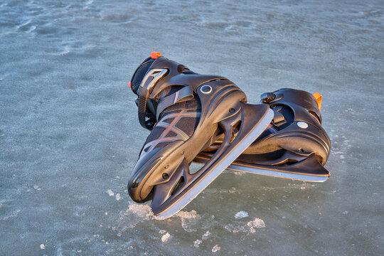 pair of men ice skates on a frozen lake in Colorado
