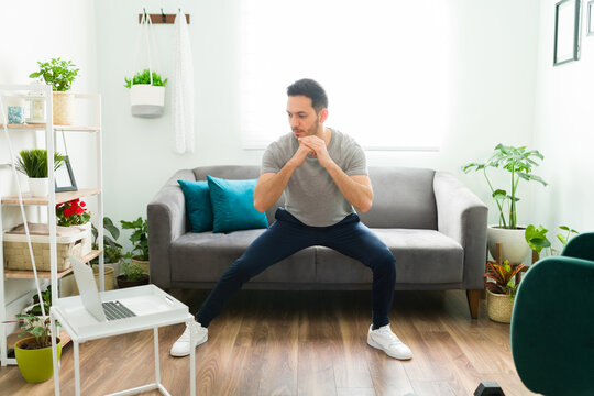 Adult man with a healthy lifestyle exercising at home