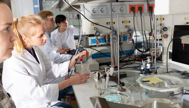 Portrait of group of European and Chinese scientists working together at biochemical laboratory