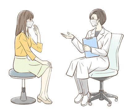 カウンセリングするドクターと女性患者_マスクあり背景なし