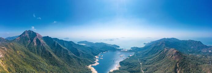 Panorama of the Shek Pik reservoir, the famous hiking location in Lantau Island, Hong Kong
