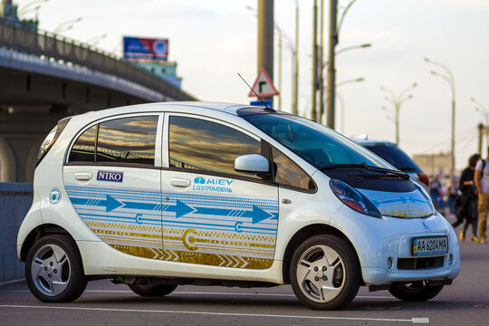 Kyiv, Ukraine - July 15, 2017: A modern small white electric car parked on city street. Environment friendly vehicle. Energy saving and future of urban transportation concept.