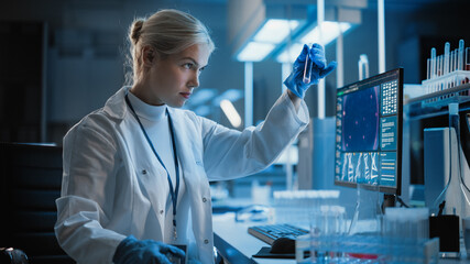 Medical Research Laboratory: Portrait of Female Scientist Working on Computer, Analysing Liquid...