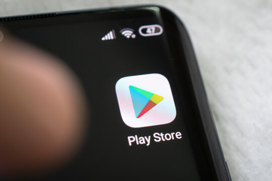 Google play store app on the screen of a black smartphone.