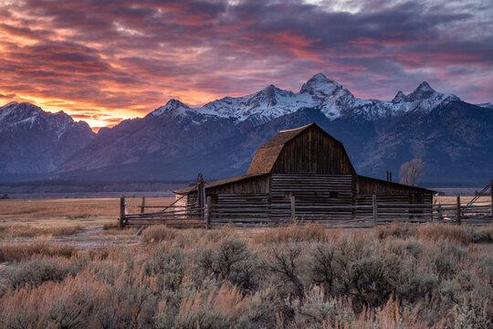 Sun setting over the Teton Range at Moulton Barn, Grand Teton National Park, Wyoming, United States of America, North America