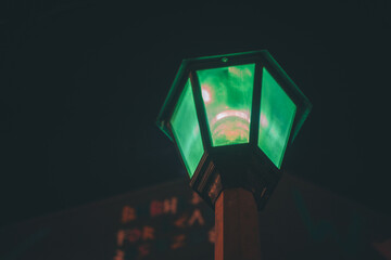 street lamp in night color green