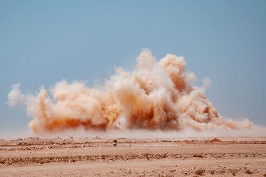 Dust clouds during detonator blast in the Arabian desert